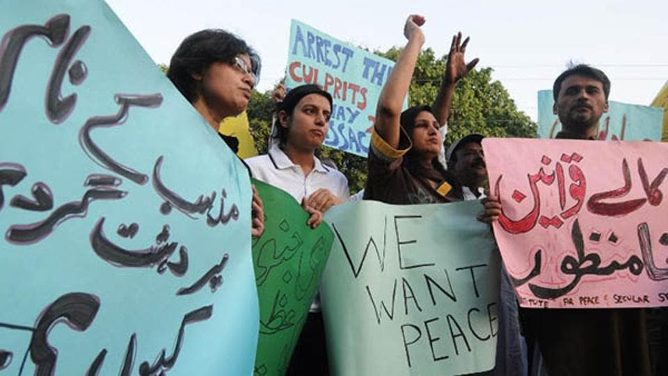 Pakistani civil rights activists protest the killings of Ahmadis in the country.