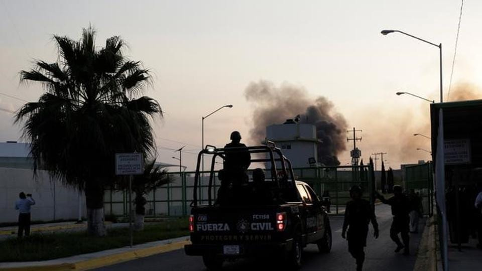 Smoke rises from inside the Cadereyta prison after a riot broke out at the prison, in Cadereyta, on the outskirts of Monterrey, Mexico March 27, 2017.