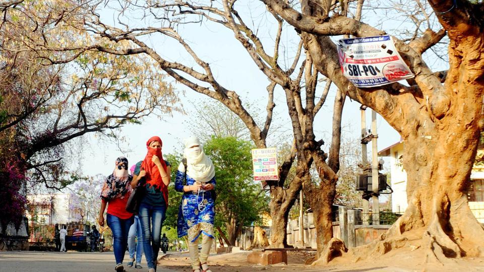 Commuters covering their faces trying protect themselves from soaring temperature of the season in Ranchi