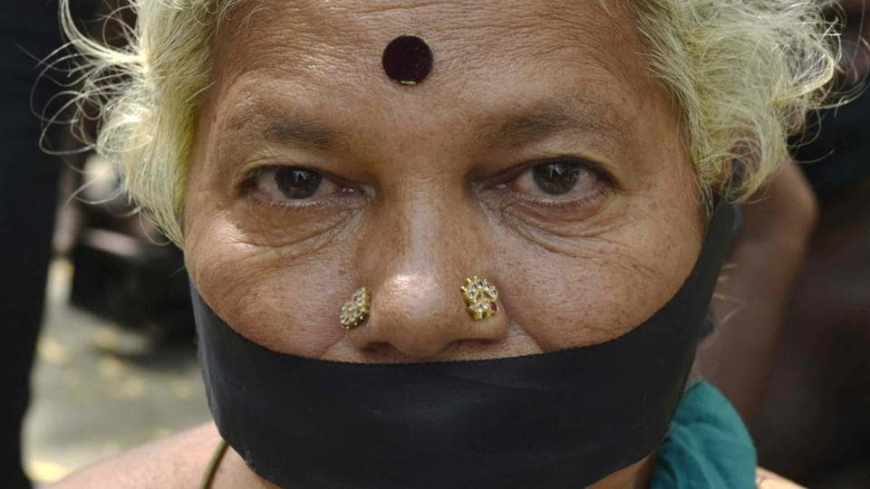A lady covered her mouth with a black strip of cloth in protest. (Vipin Kumar/HT PHOTO)