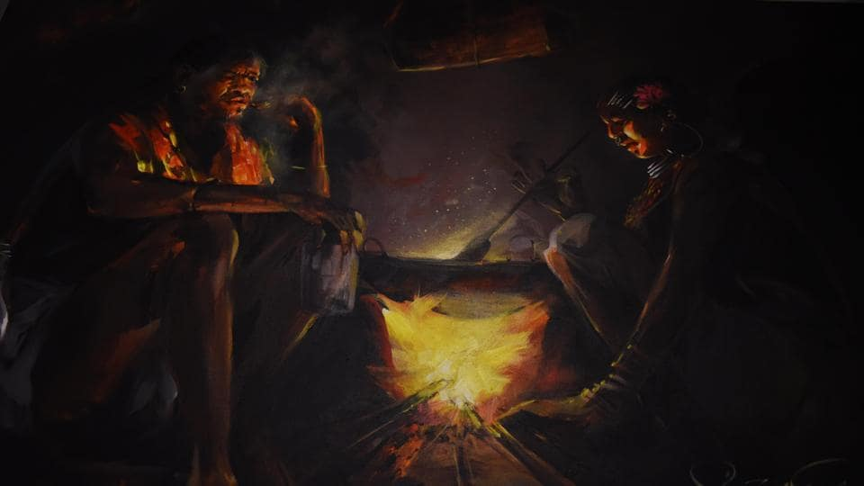 A painting showing tribals sitting around a traditional kitchen fire made by a tribal student. (Arabinda Mahapatra/HT Photo)