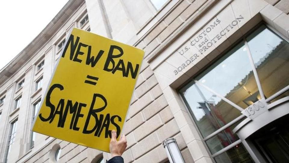 Immigration activists rally against the Trump administration's ban against travellers from six Muslim-majority nations in Washington.