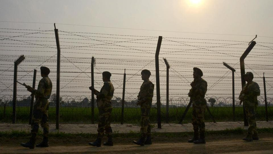 This photo taken on February 20, 2017 shows Border Security Force (BSF) personnel patrolling along a fence at the India-Pakistan border, at Wagah some 35kms from Amritsar.
