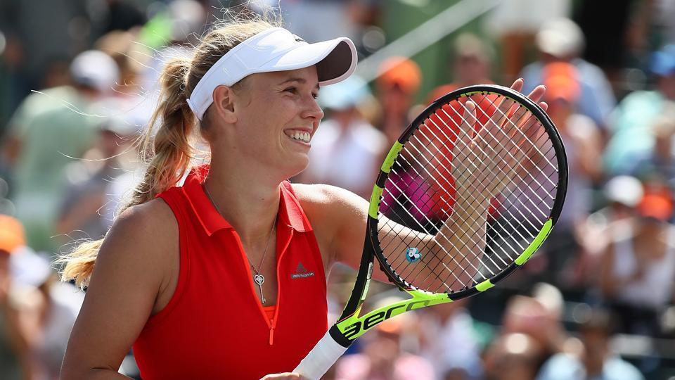 Caroline Wozniacki reacts winning the match point against Karolina Pliskova at the Miami Open.
