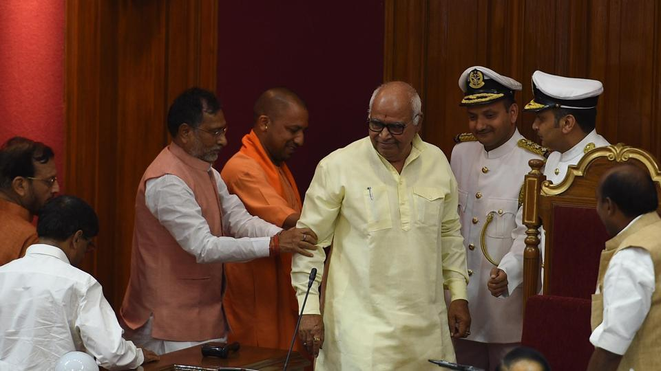 CM and LoP escorting newly-elected speaker to the chair.