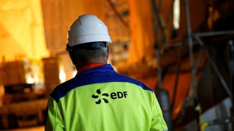 An EDF worker is seen November 16, 2016 on the construction site of the third-generation European Pressurised Water nuclear reactor (EPR) in Flamanville, France.