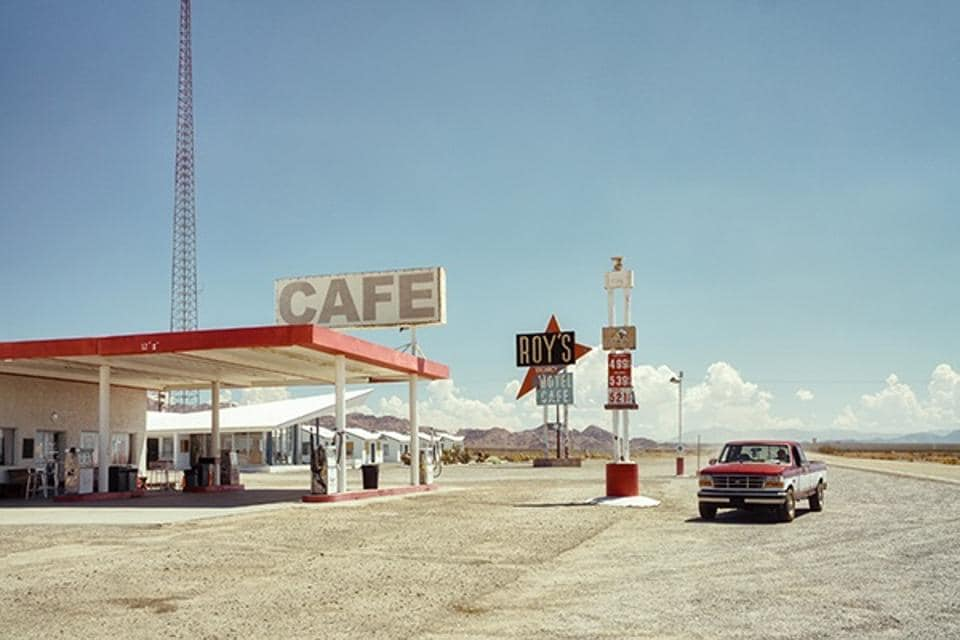 """Ralph Gräf won the first prize in the category of Open Travel for his photo """"Gasing Up At Roy's,"""" which freeze-frames the iconic roadside gas station and motel in the California desert off Route 66."""