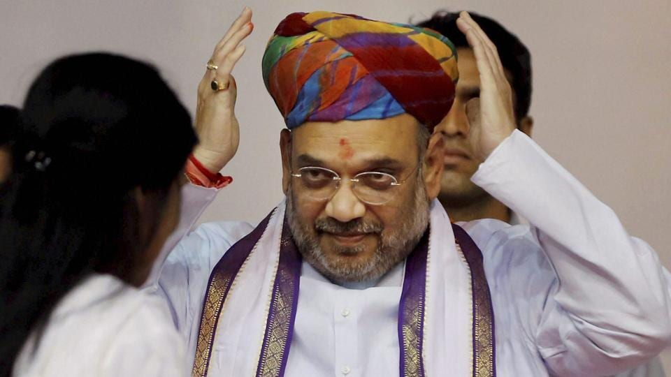 BJP president Amit Shah is presented a turban during a party workers' meeting in Ahmedabad on Thursday.