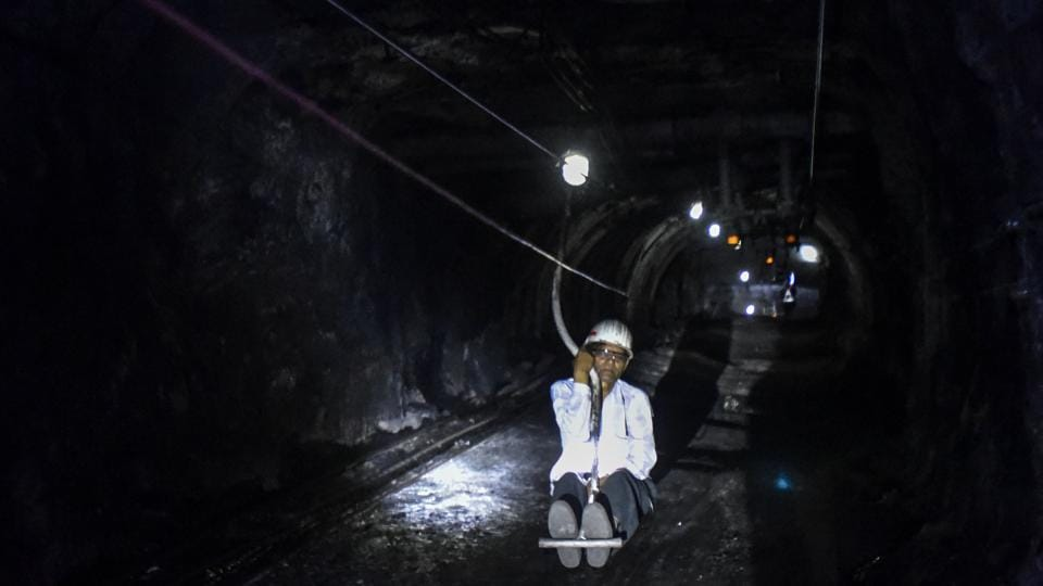 "Every tourist must wear a torch helmet and reflective jackets. Then they take the man-riding system down into the mine. A safety officer accompanies each group. ""The descent to the bottom of the mine is thrilling in itself,"" says engineering student Ujjwal Lende, 22, from Nagpur (not in frame). ""It's eerie to be swaying and bobbing down a dark dark tunnel."" (Kunal Patil / HT Photo)"