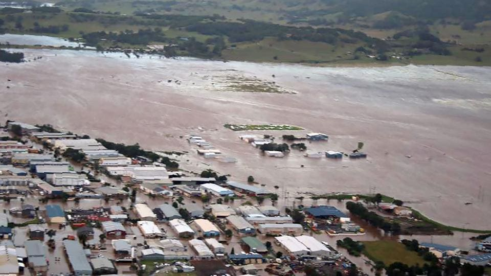 this image shows an aerial view of the flooding in the northern New South Wales town of Lismore after the area was hit by Cyclone Debbie. Tens of thousands of people have been evacuated from towns in two Australian states and authorities are searching for several missing residents amid severe flooding as the ex-tropical cyclone moved offshore. (AFP)