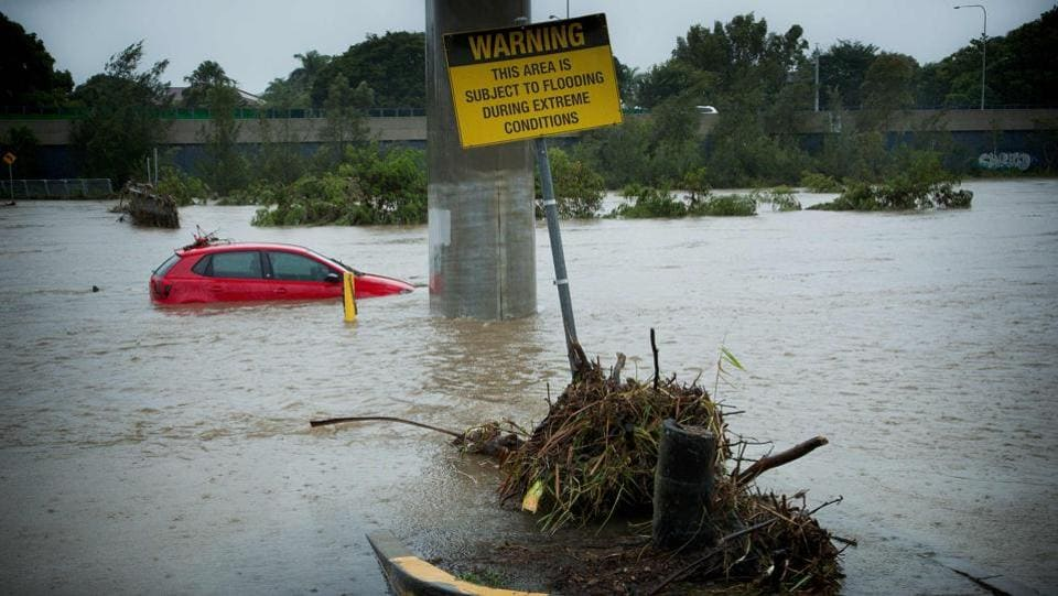 Submerged cars sit abandoned in a flooded car-park in Toombul. (Patrick Hamilton/AFP)