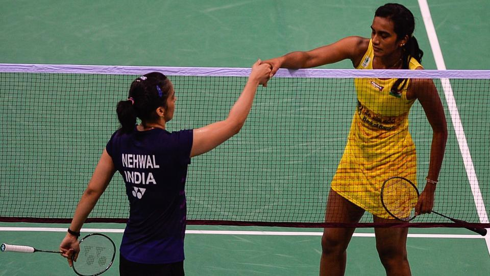 PV Sindhu (right) shakes hands with Saina Nehwal after winning the women's singles India Open superseries quarterfinal match at the Siri Fort Sports Complex in New Delhi on Friday.