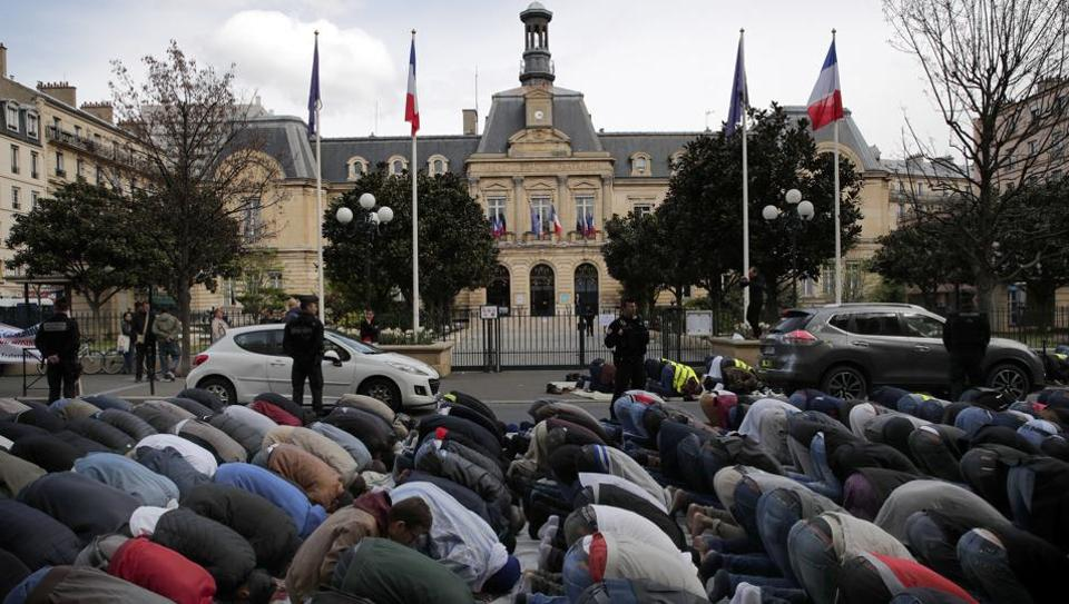 Muslims Protest With Street Prayer In Paris Over Closure