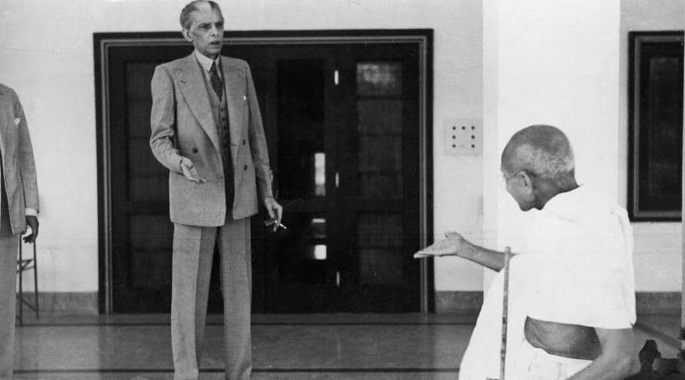 Mohandas Karamchand Gandhi leaves the home of Mohammad Ali Jinnah, founder of Pakistan, en route to the Viceroy's Lodge in Delhi on November 24, 1939.