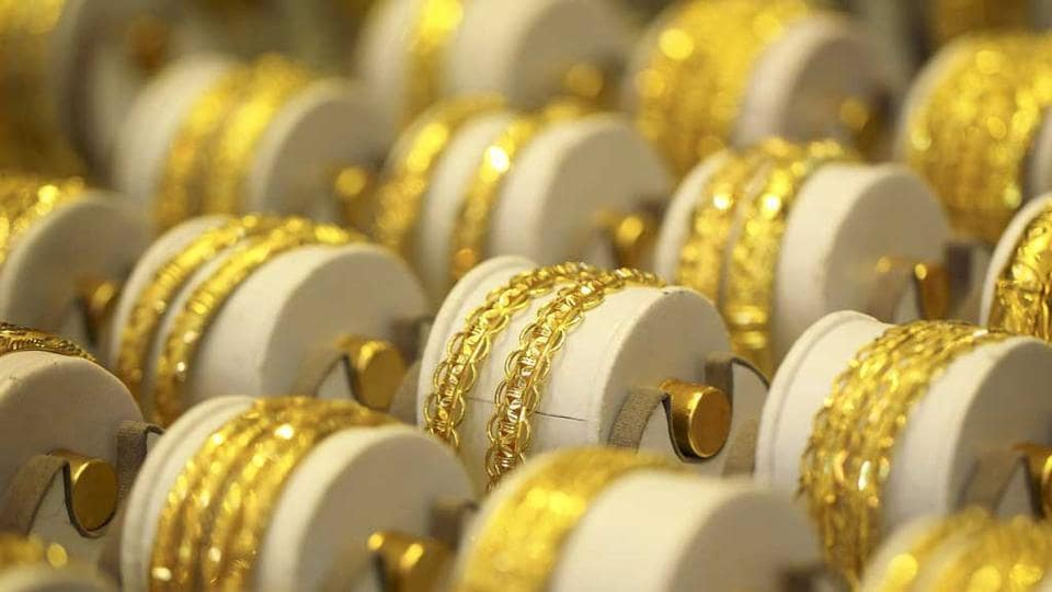 Gold prices will edge higher this year even in the face of a persistent surplus of physical metal, GFMS analysts at Thomson Reuters said.