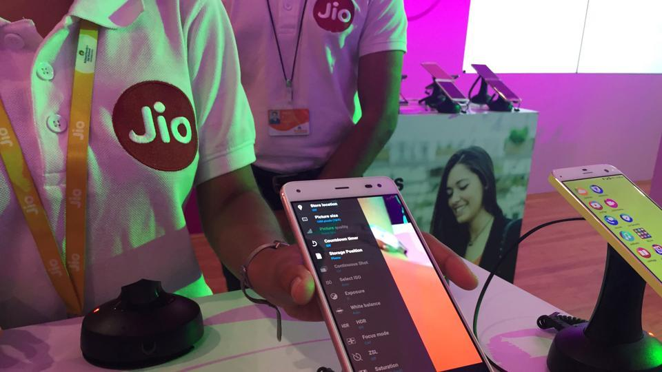 A Reliance employee demonstrates Jio LYF phone at their headquarters on the outskirts of Mumbai.