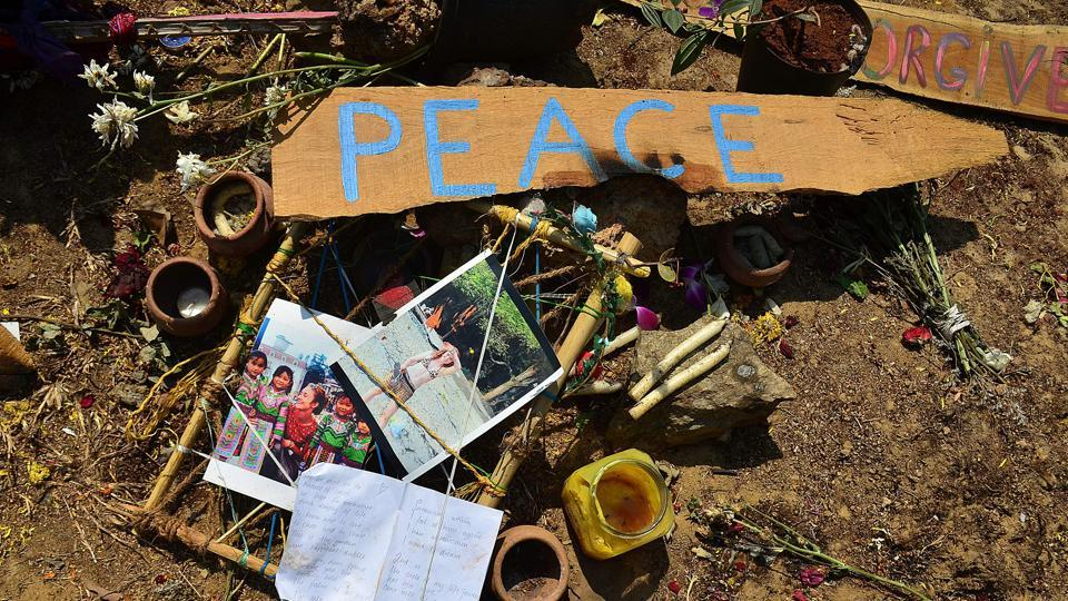 Artifacts placed by mourners at the location where the body of Irish tourist Danielle McLaughlin was found in Canacona, in Goa.