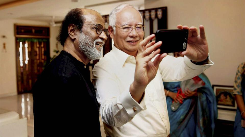 Malaysian Prime Minister Najib Razak clicks a selfie with Tamil super star Rajinikanth at his home in Chennai on March 31, 2017.