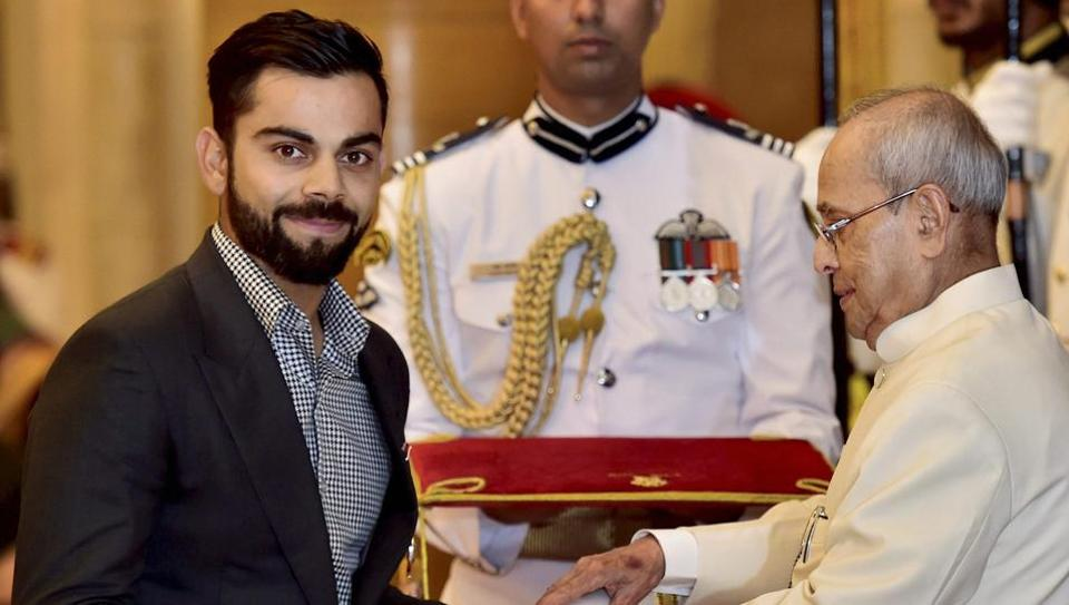 President Pranab Mukherjee confers the Padma Shri on Indian cricket team captain Virat Kohli at the Rashtrapati Bhavan in New Delhi on Thursday.