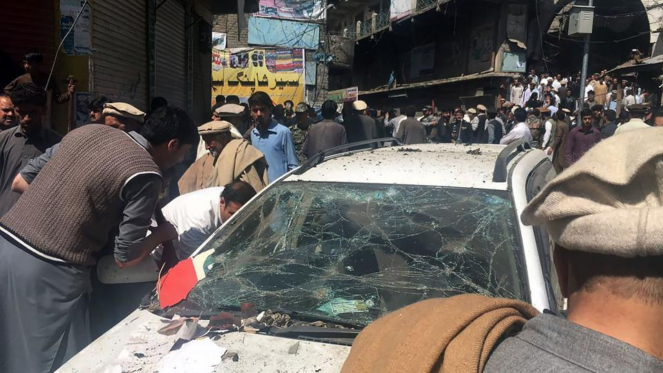 Pakistanis gather at the site of a powerful explosion at a market in Parachinar, capital of Kurram tribal district, on March 31, 2017. At least 22 people were killed and nearly 70 more wounded when a car bomb tore through a market in the mainly Shia area of Pakistan's tribal belt, officials said.