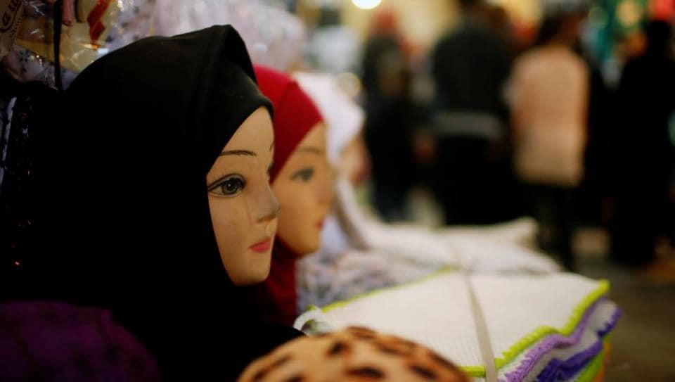 Mannequins displaying headscarfs at a market in Iraq.