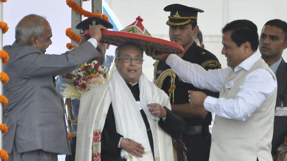 Assam chief minister Sarbananda Sonowal (right) and Governor Banwarilal Purohit (left) present a traditional hat Japi to President Pranab Mukherjee at the Namami Brahmaputra festival in Guwahati on Friday.