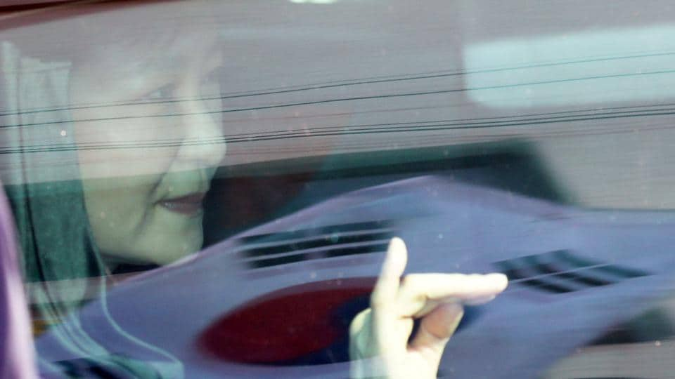 South Korea's ousted leader Park Geun-hye looks out from a vehicle as she leaves her private house in Seoul, South Korea, on March 30.