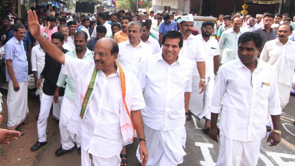 Muslim League candidate P K Kunhalikutty waves to people while on his campaign trail in Malappuram.