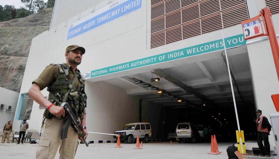 A security personnel stands guard outside the Chenani-Nashri tunnel ahead of its inauguration.