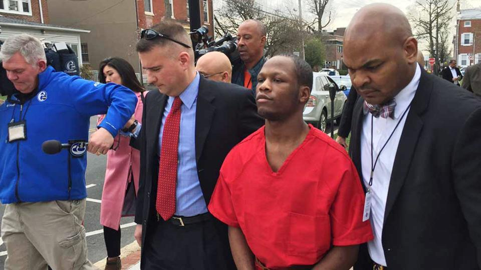 Dejohn Lee, accused of raping at least nine women, starting when he was 16, is escorted by police to an arraignment hearing in Media, Pa, on Thursday.