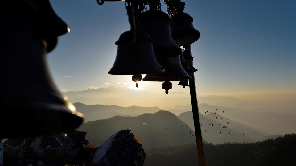 Sunset above Rudraprayag, at the Kartik Swami Temple where after evening prayers bells ringing can be heard from afar. (Gurinder Osan/HT Photo)