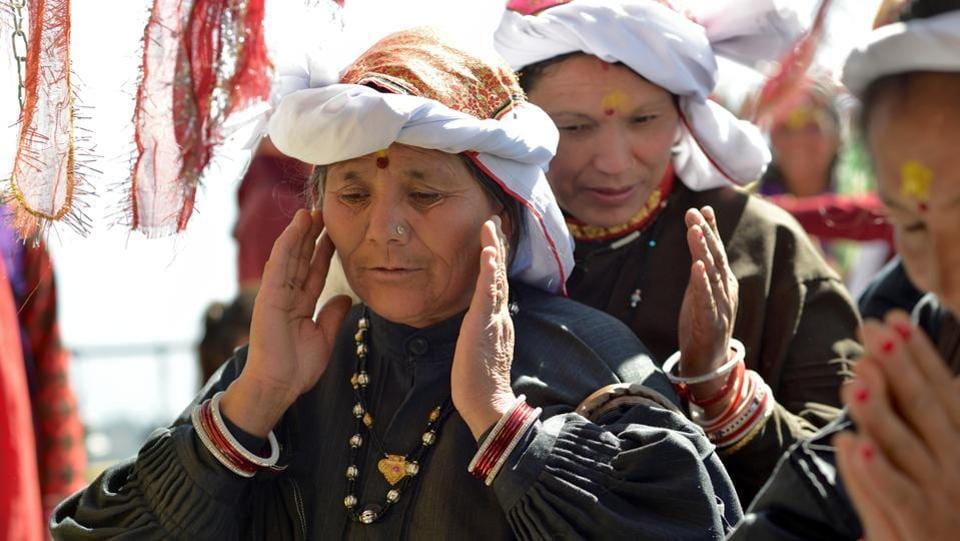 Village womenfolk seek blessings as they offer prayers to the almighty. (Gurinder Osan/HT Photo)