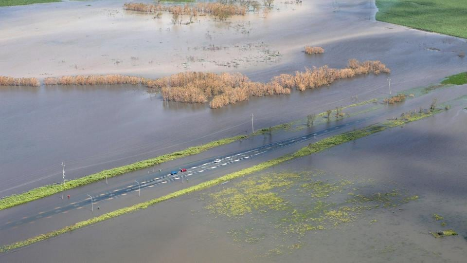 An image showing three vehicles stranded on a highway flooded after Cyclone Debbie passed through the region near the township of Gunyarra, located south of the town of Bowen in Queensland, Australia. (Australia Defence Force/Handout via REUTERS )