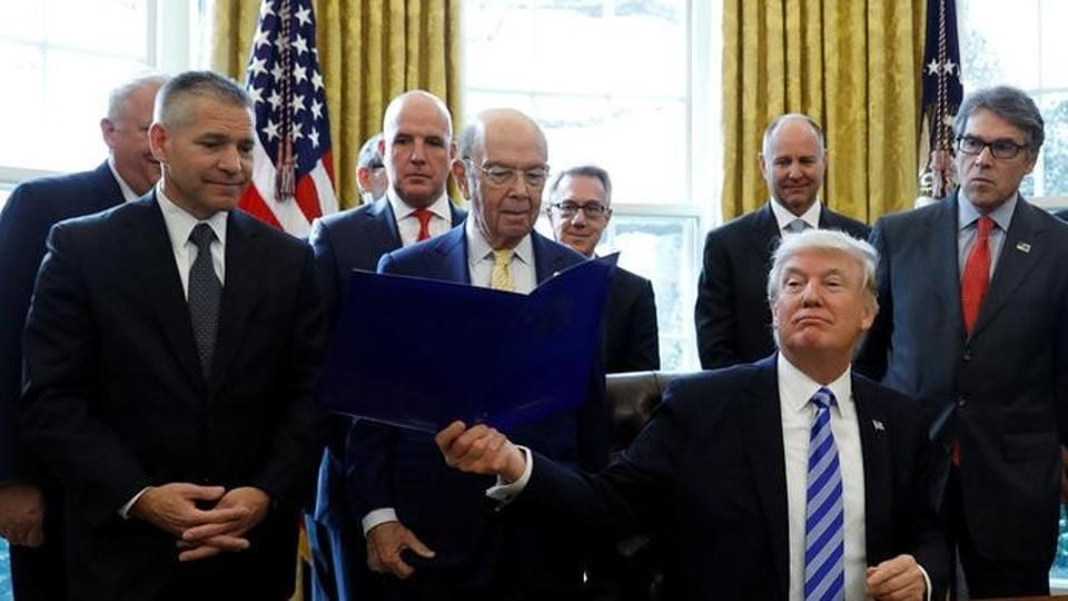 US President Donald Trump smiles after announcing a permit for TransCanada Corp's Keystone XL oil pipeline in the Oval Office of the White House in Washington,on March 24.