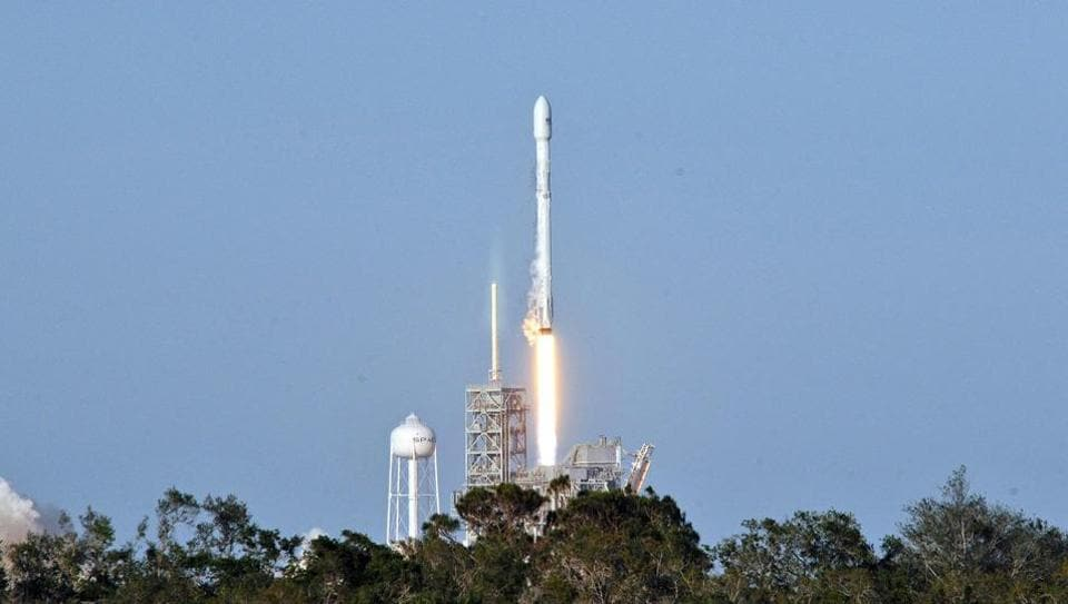 Space X's Falcon 9 rocket lifts off from space launch complex 39A at Kennedy Space Center, Florida on March 30, 2017, with an SES communications satellite. SpaceX blasted off a recycled rocket for the first time on, using a booster that had previously flown cargo to the astronauts living at the International Space Station.