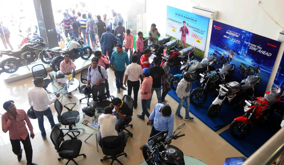 Rush of customers inside a two wheeler showroom to purchase discounted vehicles after the Supreme Court recently banned sale and registration of BS-III vehicles after March 31 in Ranchi, India, on March 31, 2017.