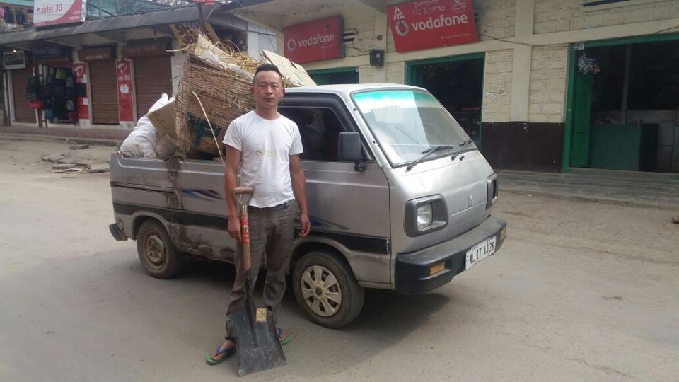 Neingupe Maru with his dumper in Pfutsero town.