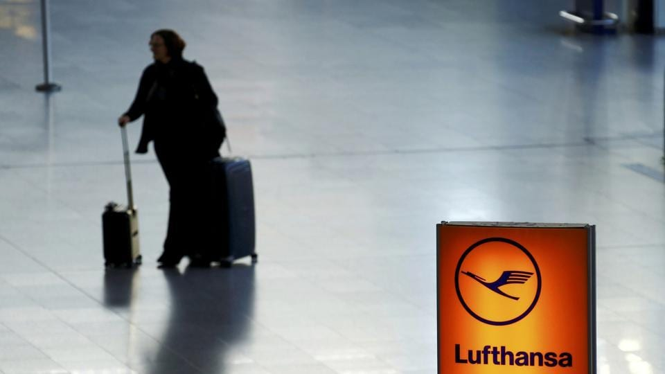 A passenger walks through a terminal at the Frankfurt airport in Germany.