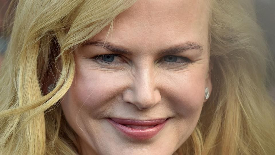 Australian actor Nicole Kidman smiles to fans during a visit to the Ferrari gargage ahead of the Formula One Australian Grand Prix in Melbourne.