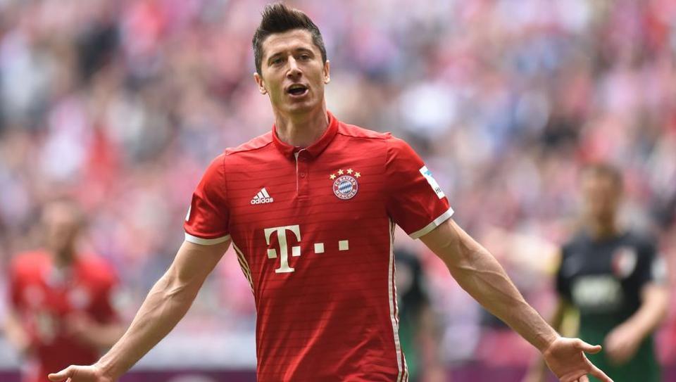 Bayern Munich's Polish striker Robert Lewandowski celebrates after scoring the first goal against Augsburg during their Bundesliga match on Saturday.