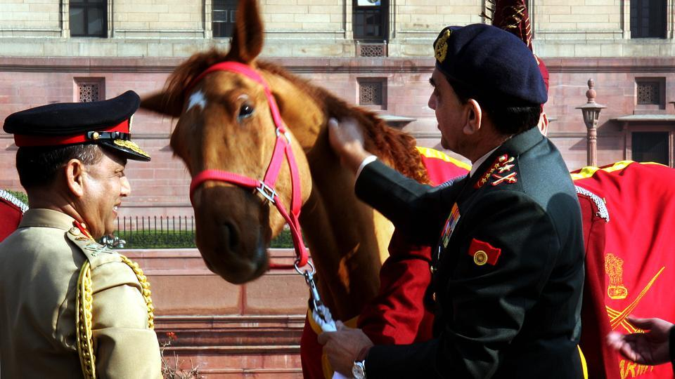 Indian Army chief general Deepak Kapoor (right) presents Bangladesh army chief general Moeen U Ahmed with a horse at a ceremony in New Delhi on February 25, 2008.