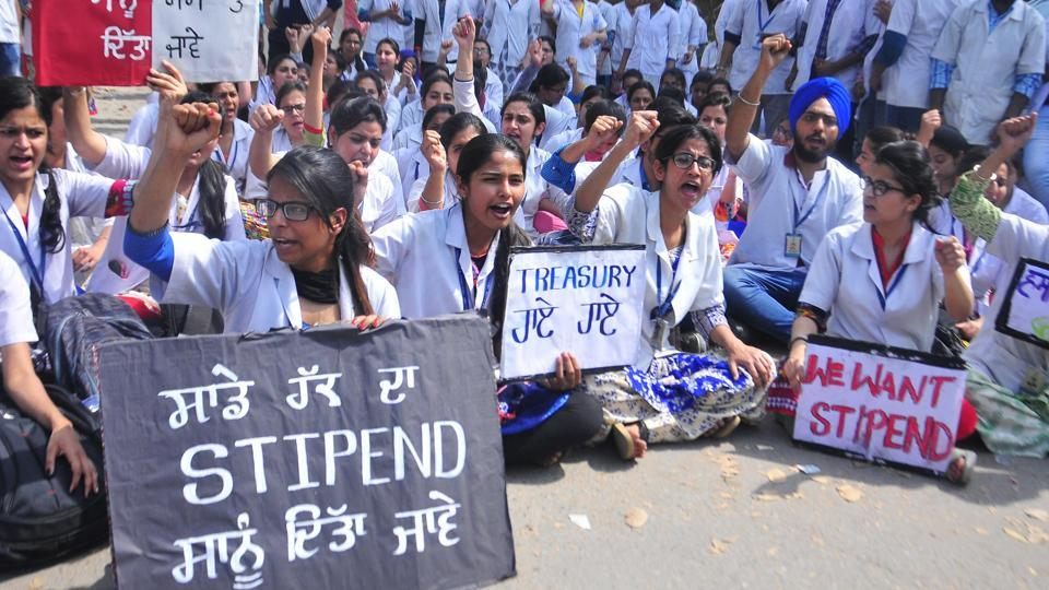 The resident dentists of Punjab Government Dental College and Hospital during a protest outside deputy commissioner's office in Amritsar on Friday.