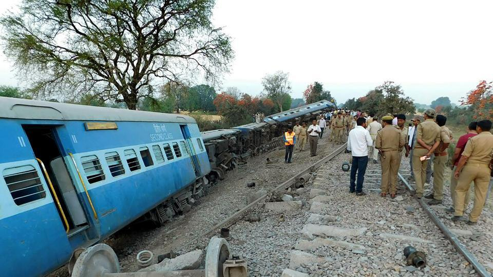 Rescue workers and officials inspect the derailed coaches of The Mahakaushal Express Train at Mahoba, 140km south-west of Kanpur.