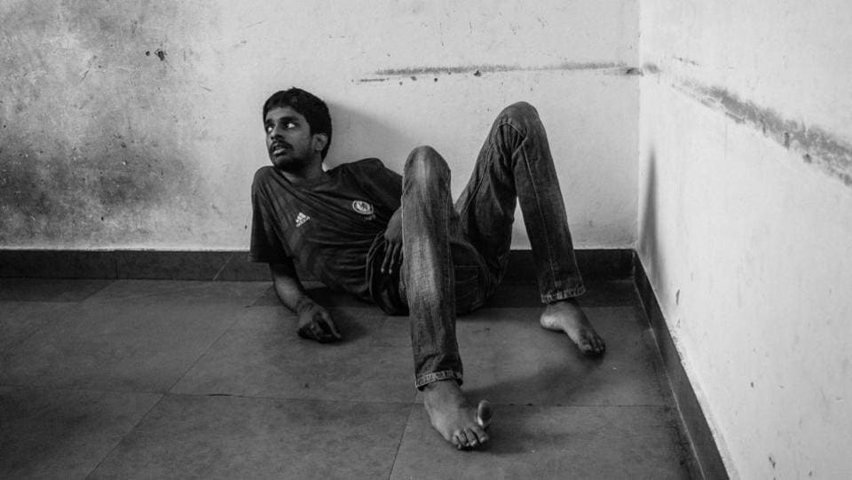 Gokul sits on the floor in a strange posture as he looks away from the camera. Autistic individuals have trouble with things that come naturally to us like pointing at things and maintaining eye contact with people, and cameras too. (Vageesh Lall/ HT Photo)