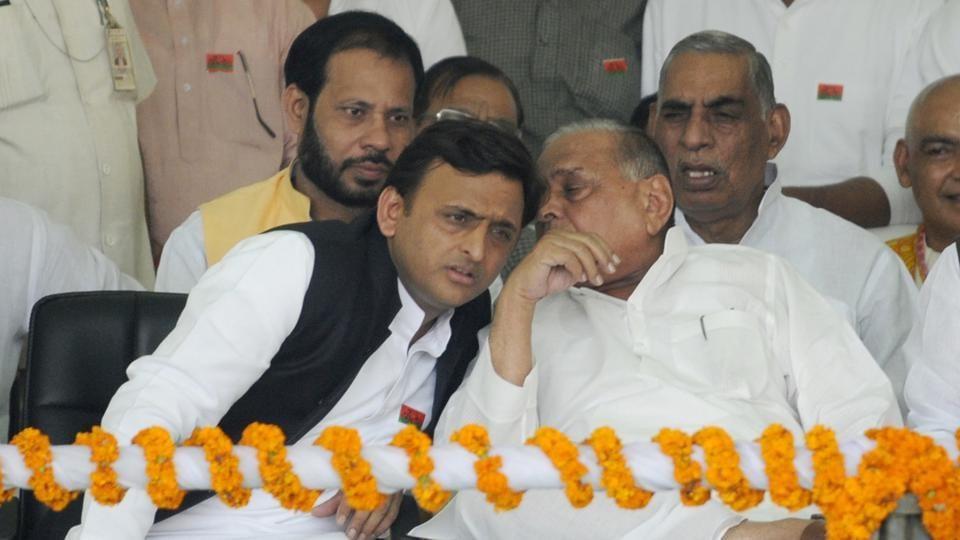 Former Uttar Pradesh CMAkhilesh Yadav has a word with his father and SP chief, Mulayam Singh Yadav, in Lucknow.