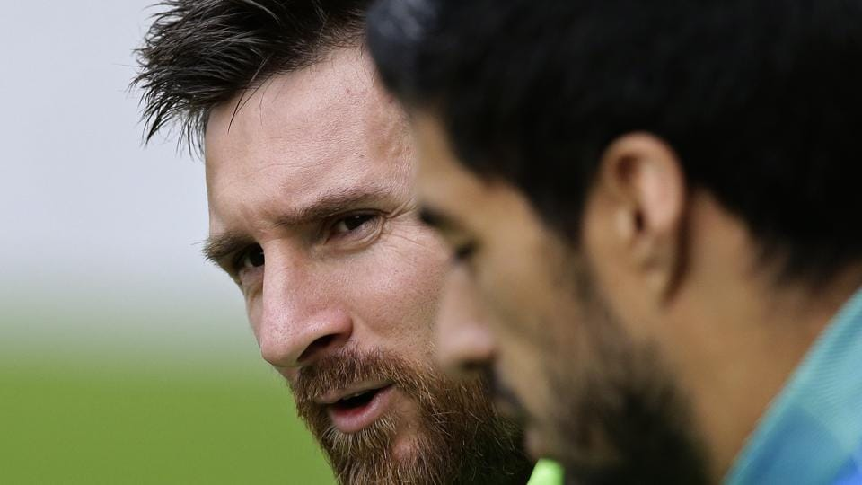 FC Barcelona's Lionel Messi (background) attends a training session at the Sports Center FC Barcelona Joan Gamper in Sant Joan Despi, Spain on Saturday.