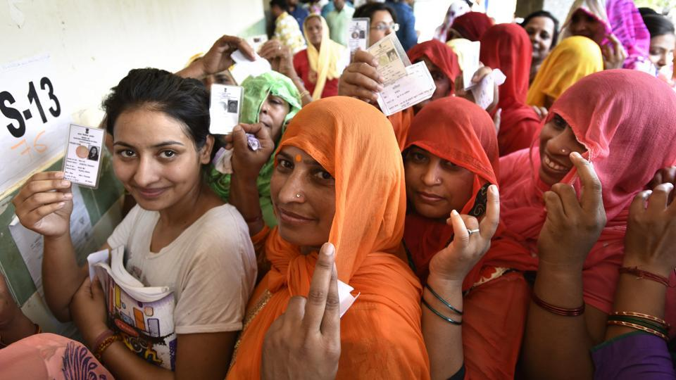 Voters wait to casti their vote in Chhattarpur during  the 2016 MCD elections in New Delhi.