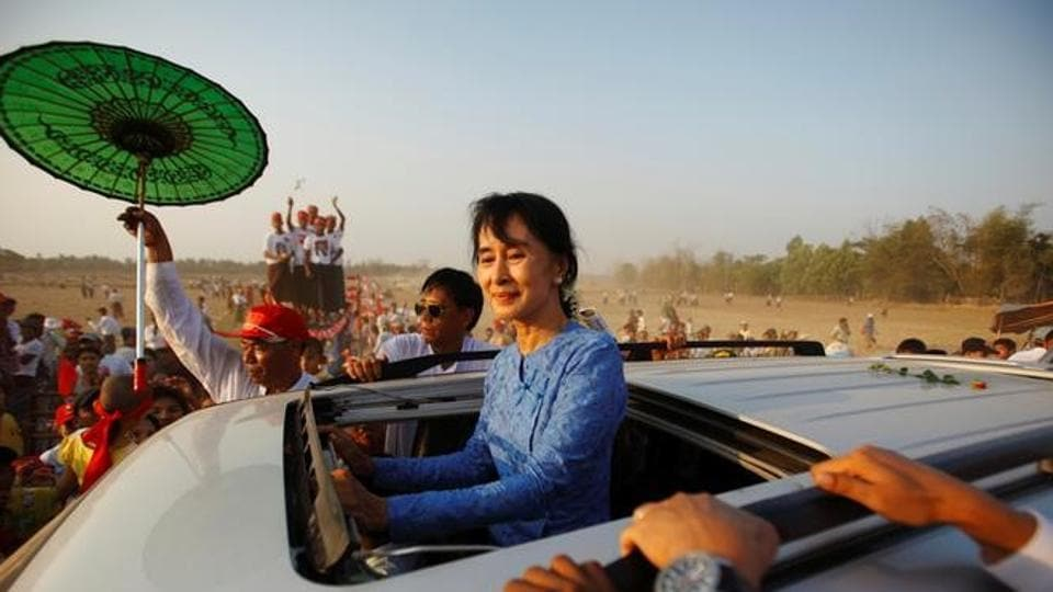 Myanmar pro-democracy leader Aung San Suu Kyi returns after giving a speech to her supporters during the election campaign at Kawhmu Township March 22.