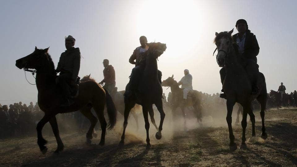 Bedouin youths ride their horses during a rally marking the 41st anniversary of Land Day, in Deir el-Balah, Central Gaza Strip. (Adel Hana / AP)