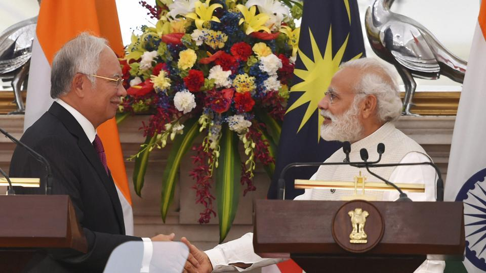 Prime Minister, Narendra Modi with his Malaysian counterpart Najib Razak shakes hands after their joint statement at Hyderabad House, in New Delhi on Saturday.